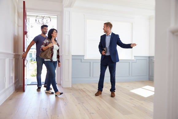 Real estate agent showing couple a house
