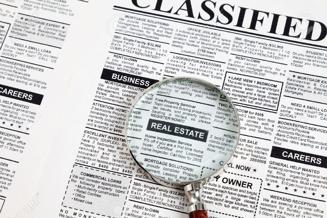 real estate classifieds section of newspaper