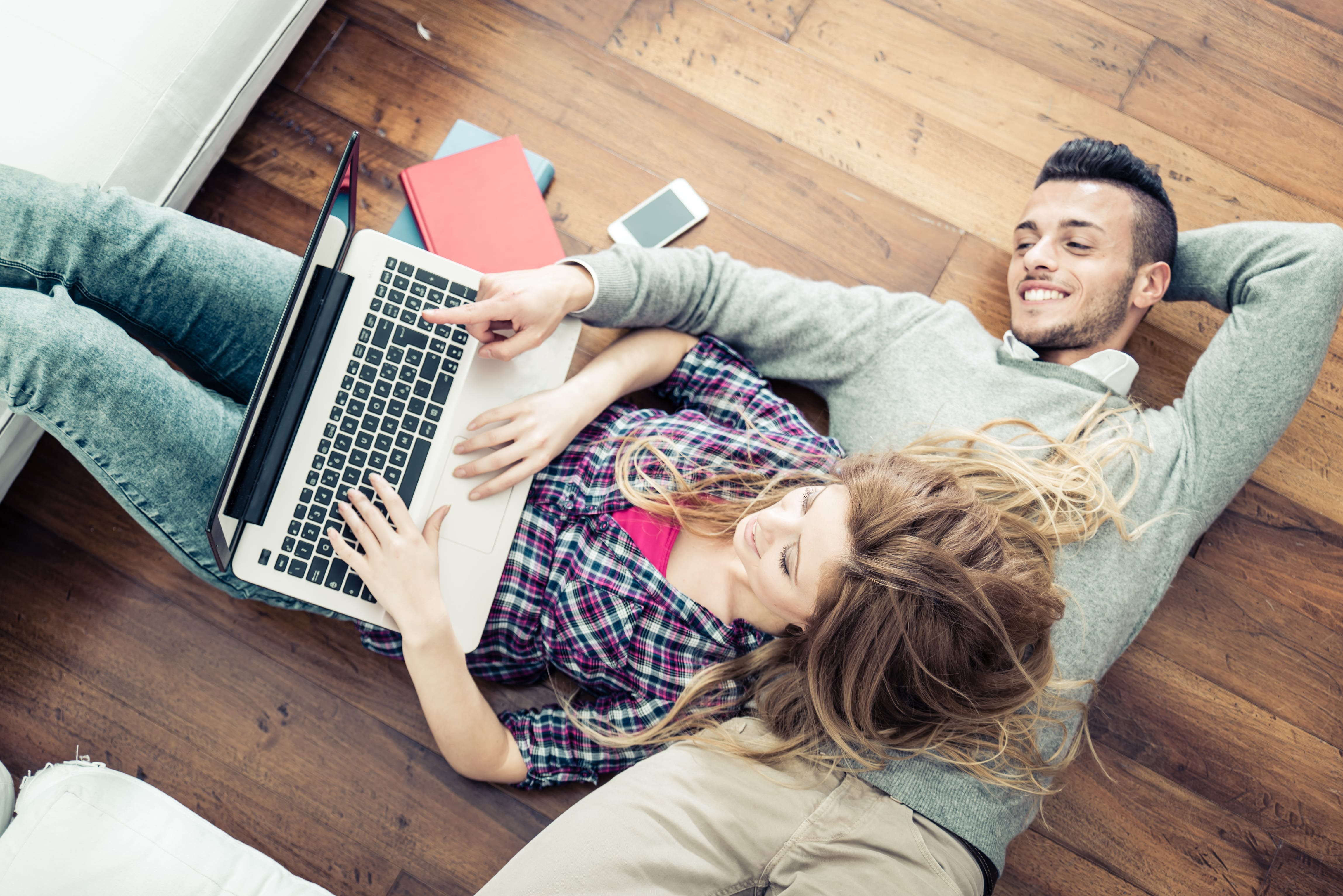Couple looking at computer laptop together.