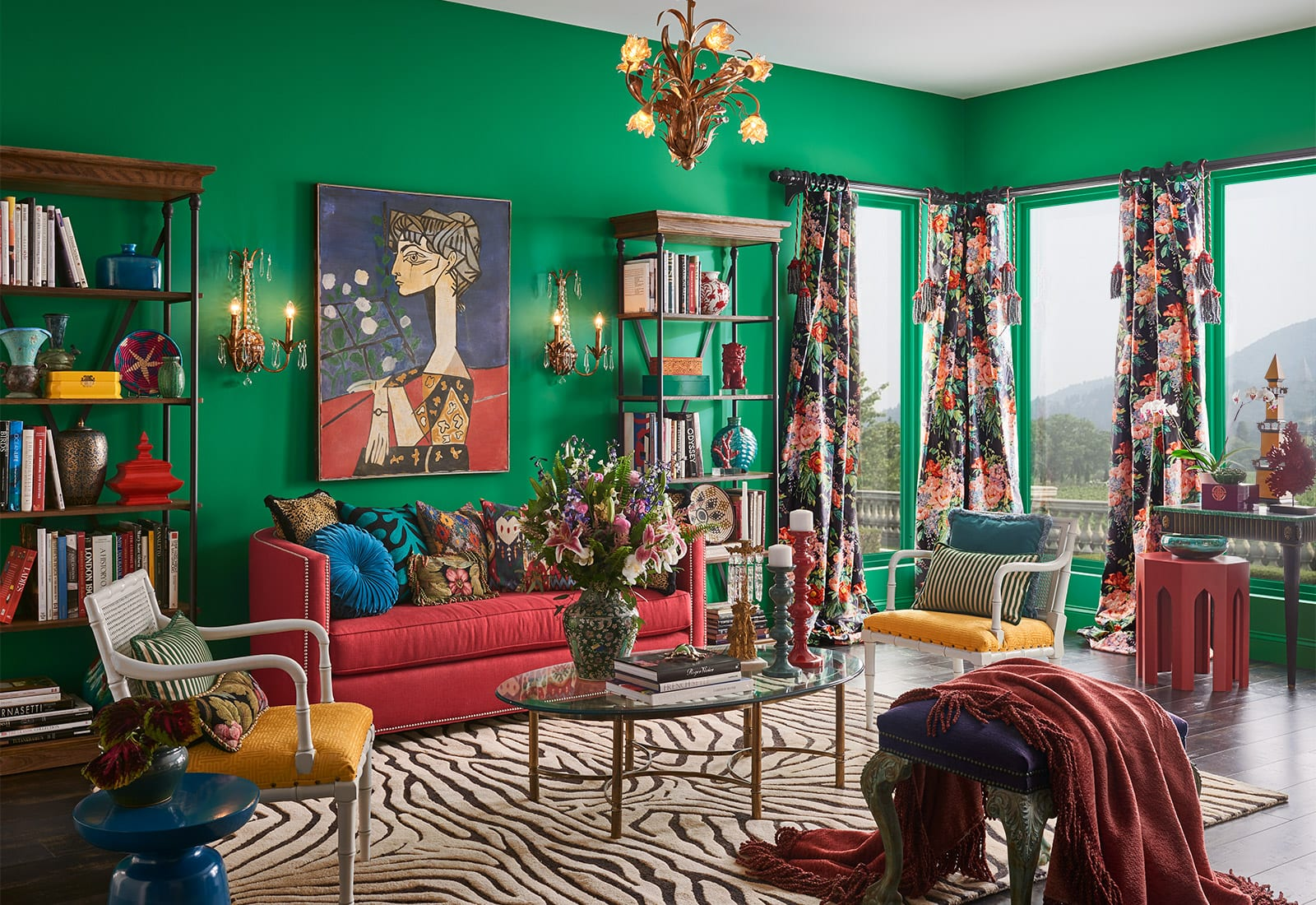Living room featuring bold green walls with zebra rug and eccentric decor.