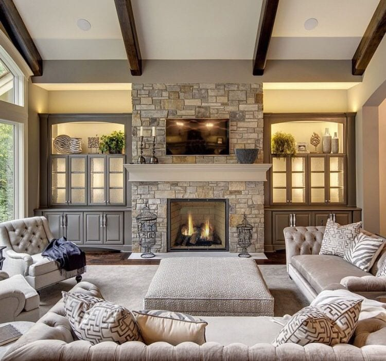 Beautifully decorated living room with a lit fireplace.