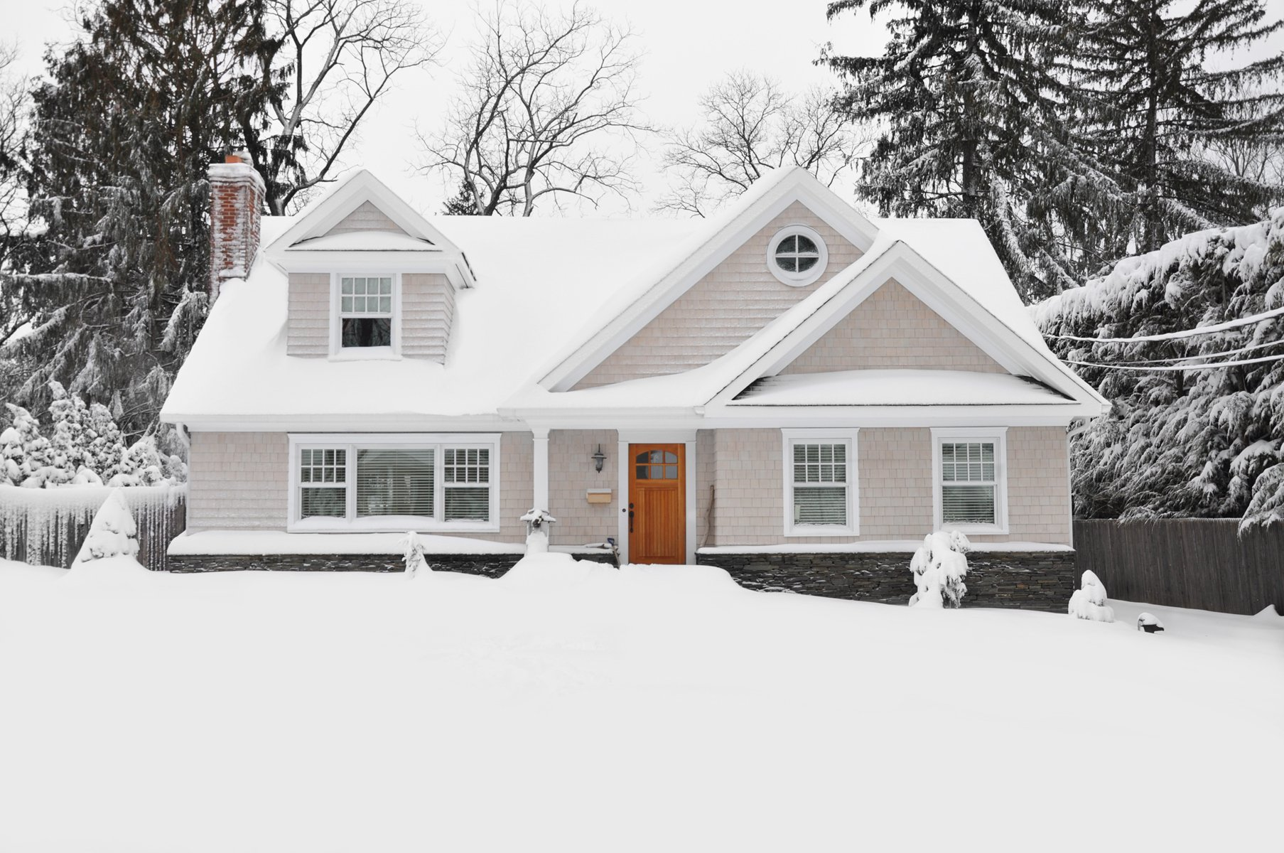 Front exterior of a home that is covered in snow.
