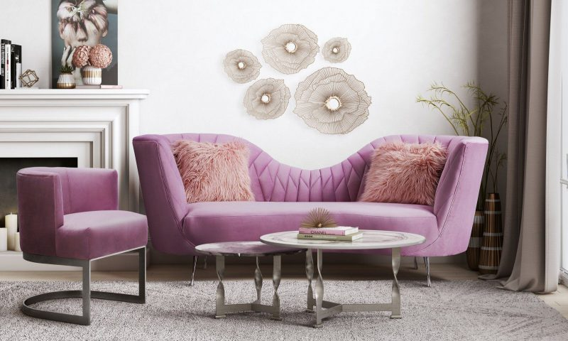 Curvy purple couch with a matching chair in a living room.