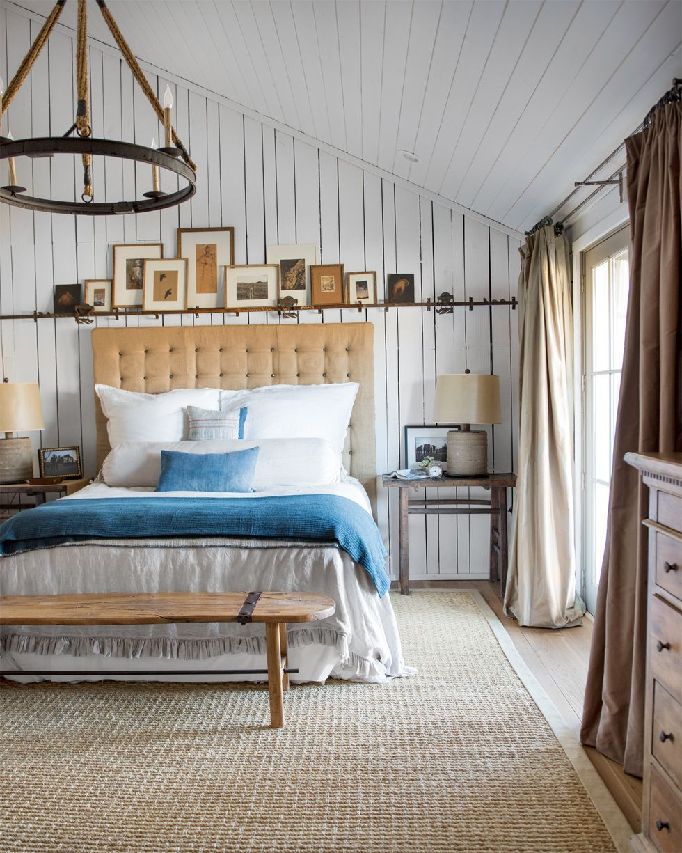 Bedroom featuring a vaulted ceiling and beautiful bed with a denim duvet cover.