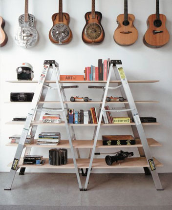 Two ladders used to create a bookshelf.
