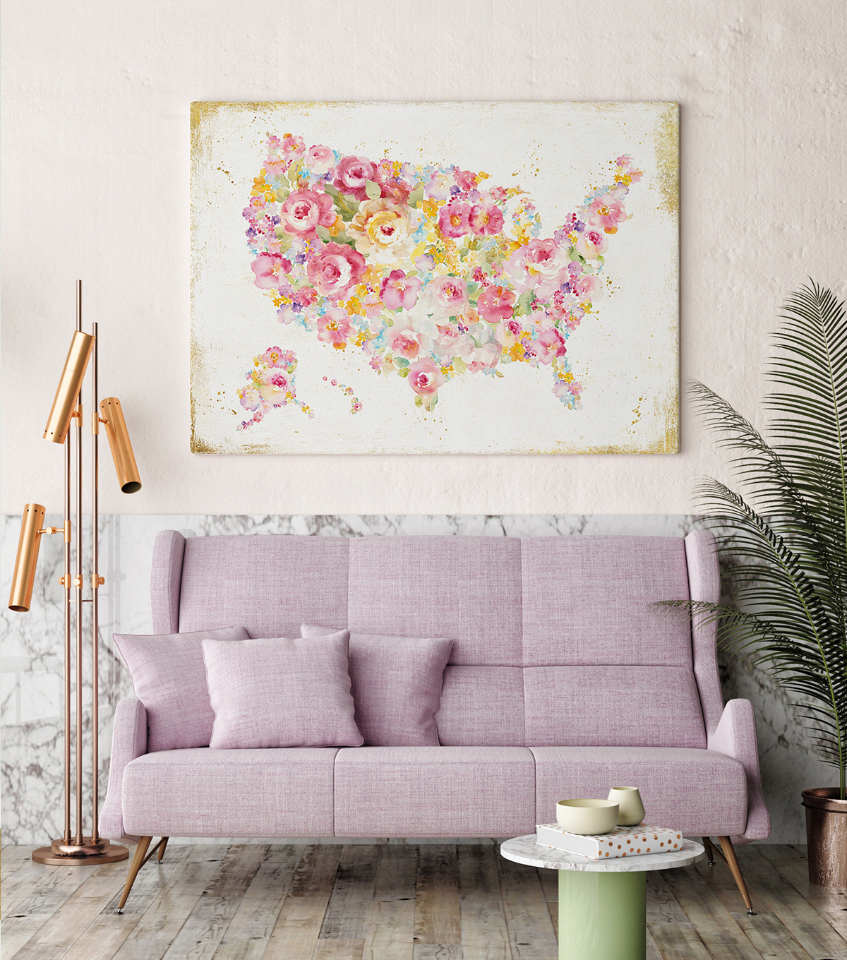 Millennial pink couch with a pink abstract painting of the US behind it.