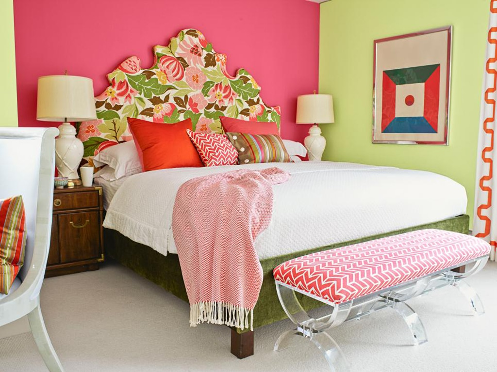 Bedroom with a millennial pink accent wall.