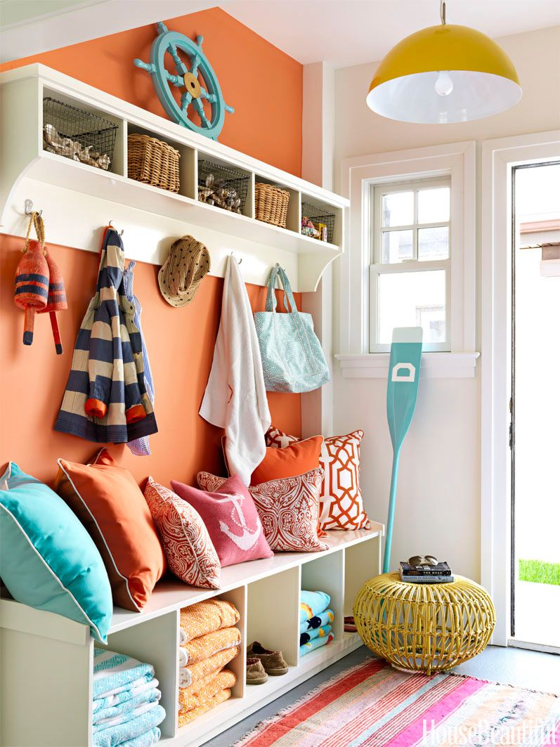 Entryway of a home with shelves used as a seating area.