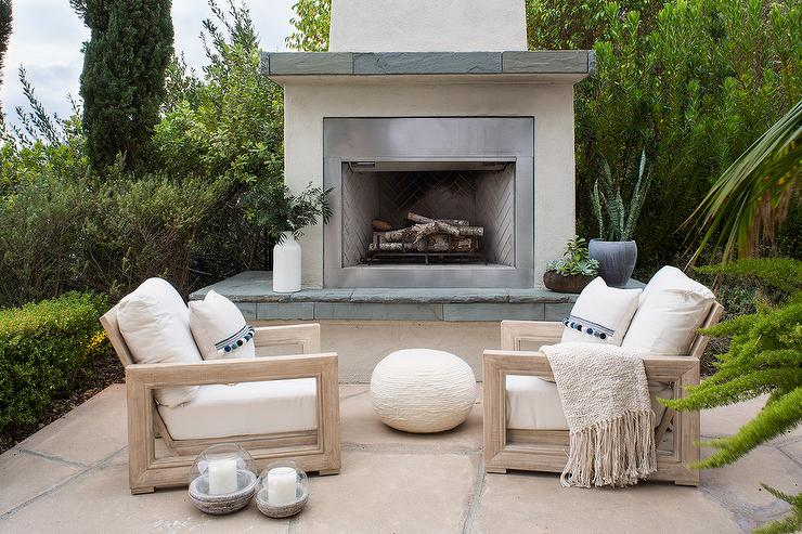 Patio furniture by an outdoor fire place
