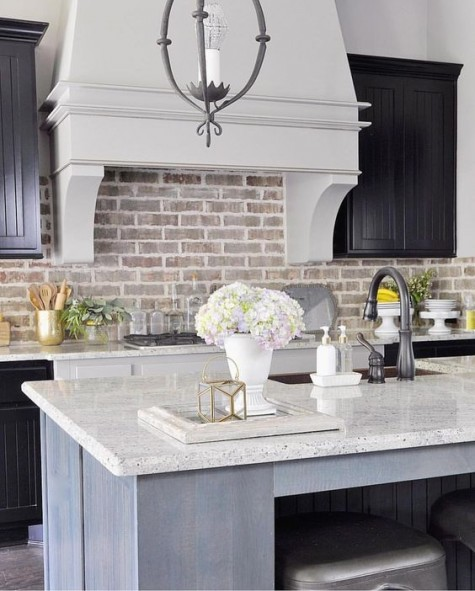 Kitchen with white tile and brick backsplash