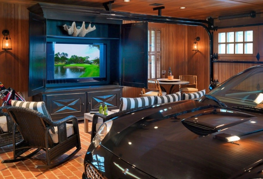 Upscale garage with tv and seating area.
