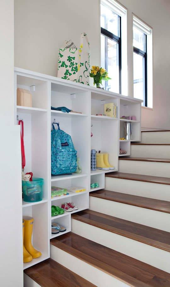Stairwell with organized cabinets on one side.