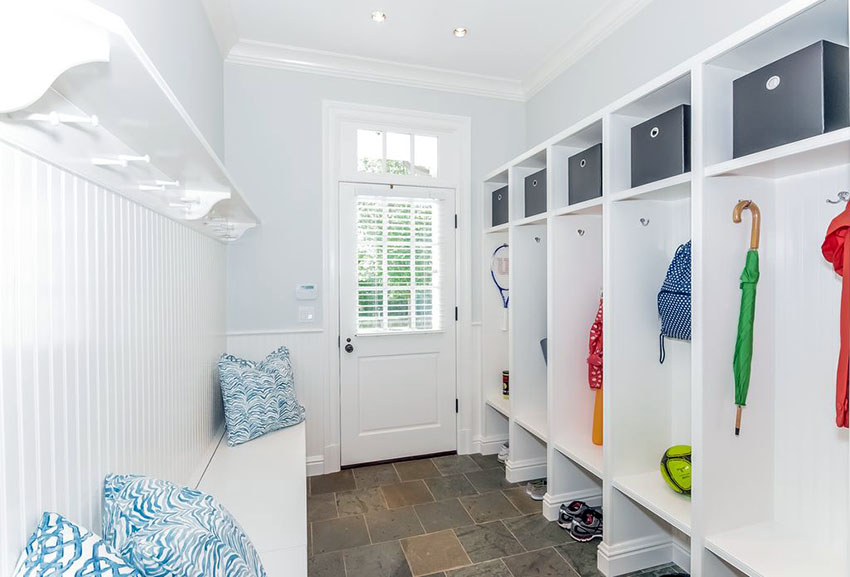 Organized mudroom with children's school supplies