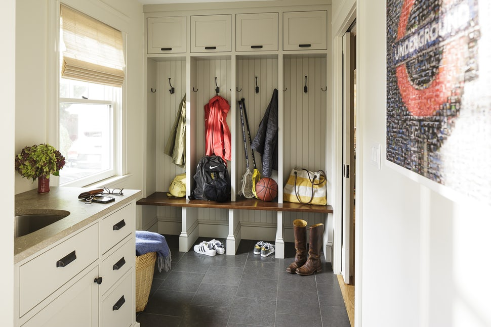 mudroom organized with sports equipment