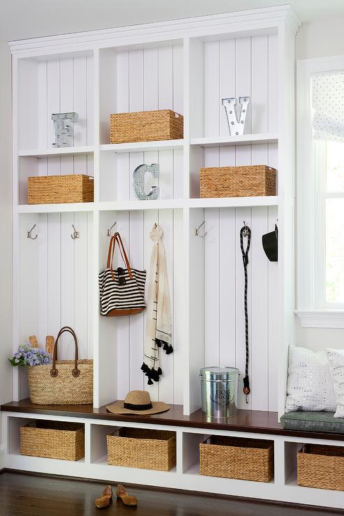 Organized cabinets with baskets in a mudroom.