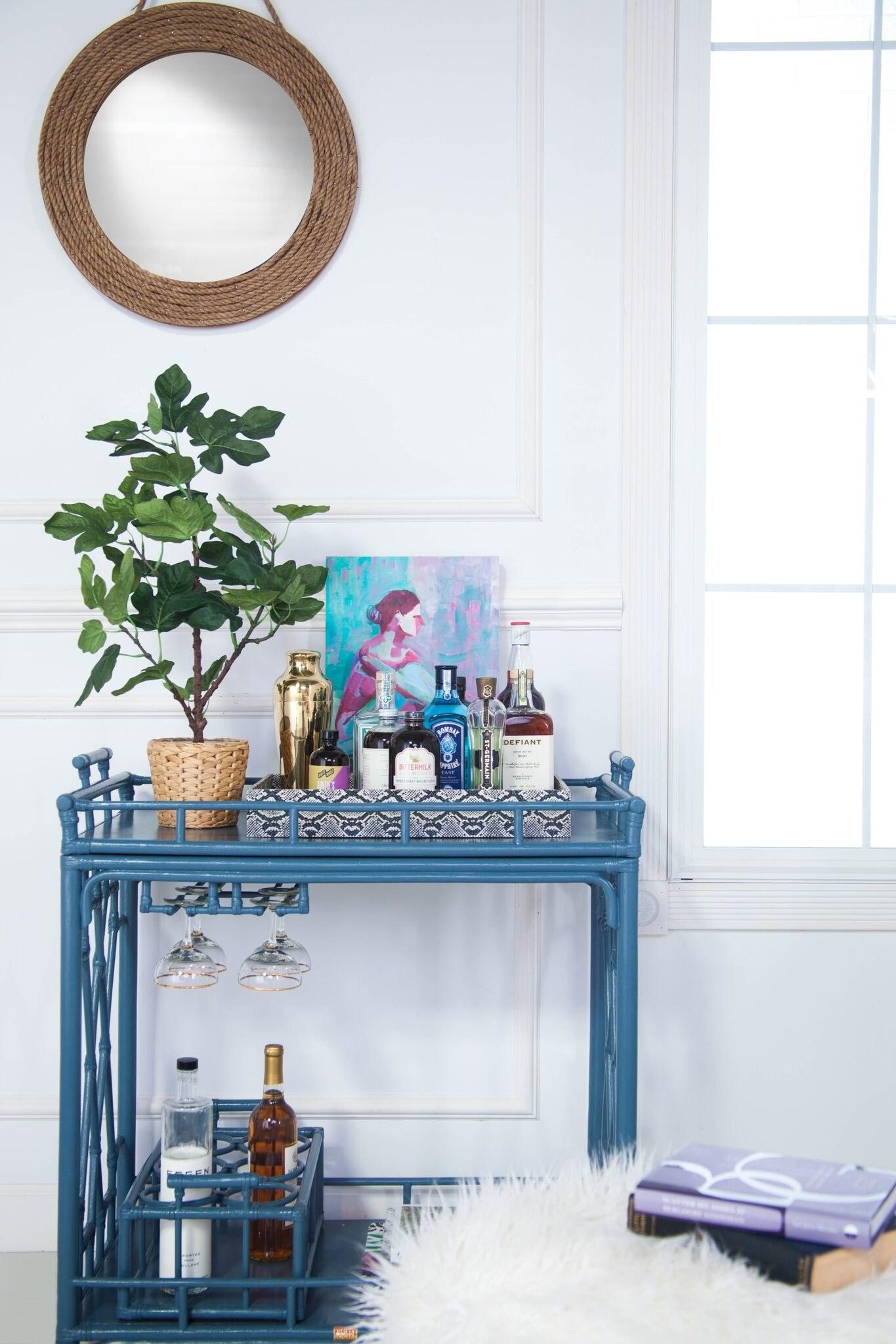 Blue bar cart in a white room