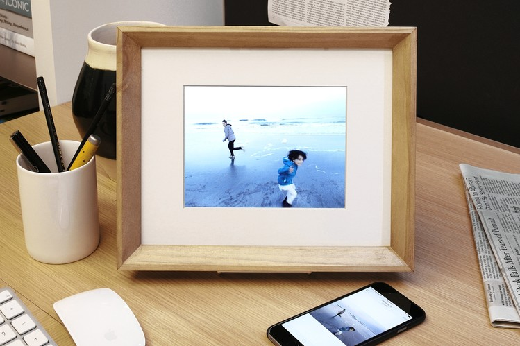 Digital picture frame on a desk