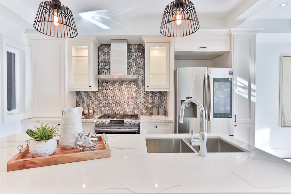 Updated kitchen with beautiful white counters