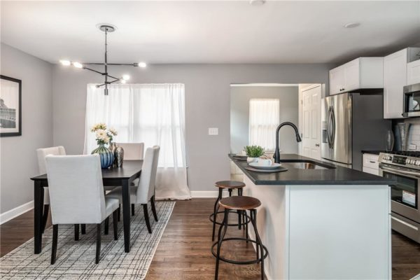 small updated kitchen with trending light fixture