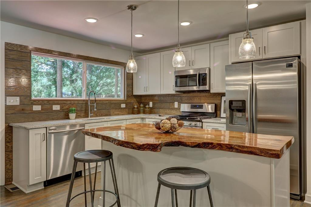 Staged kitchen with eco-friendly counter tops