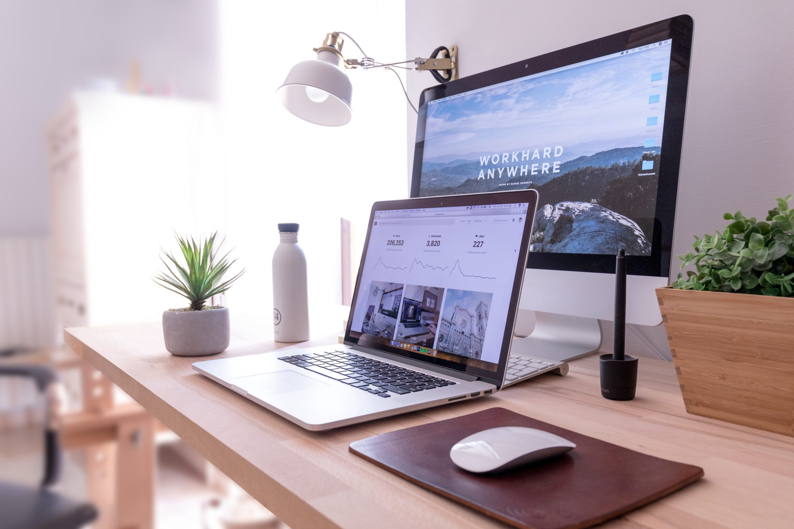 paperless desk with monitor and laptop