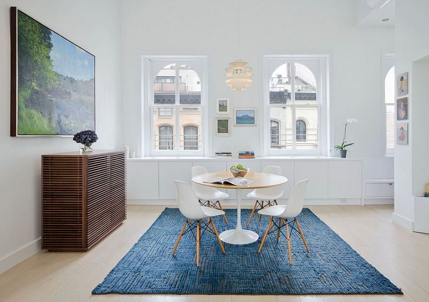 blue Scandanavian rug in a dining area