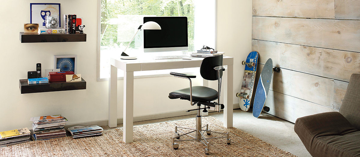 Computer desk with chair in office room