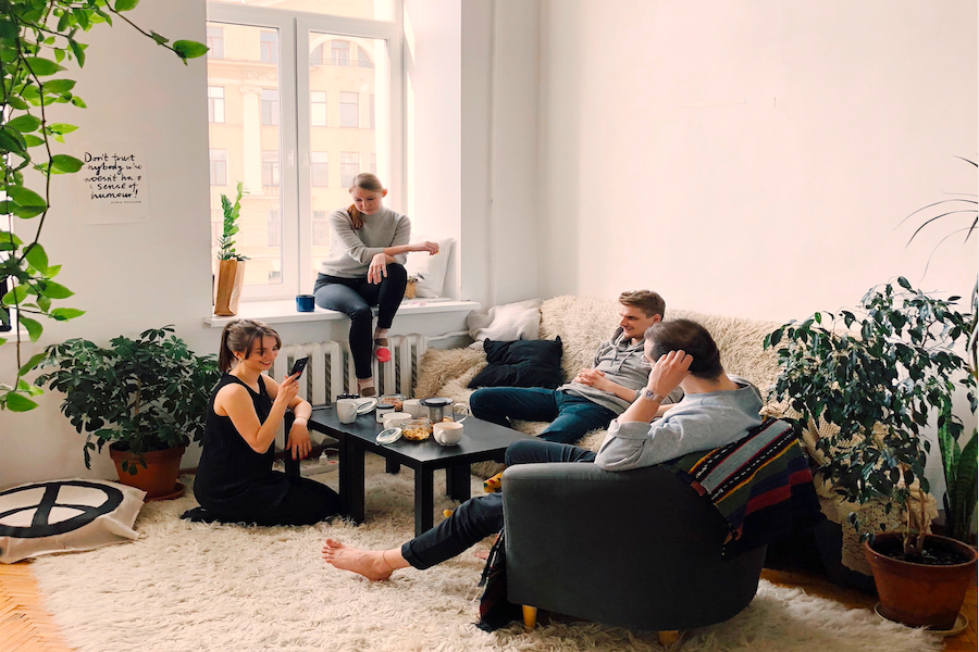 Young adults sitting in a cool apartment living room