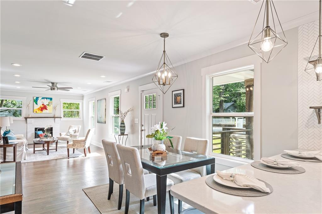 beautifully staged dining room and kitchen