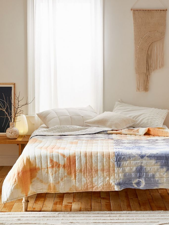 Bed with tie-dye bed spread