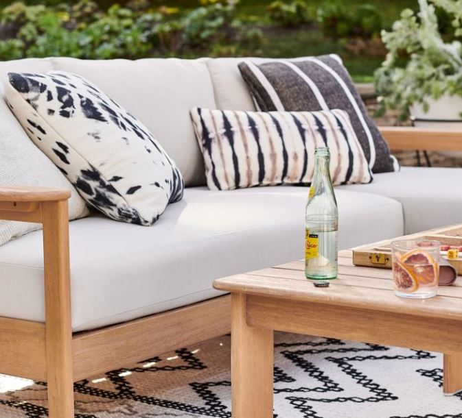 Outdoor couch with tie-dye throw pillows