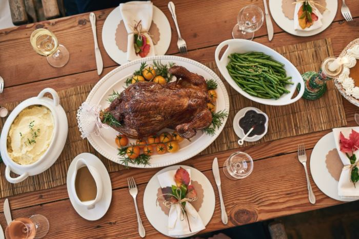 Thanksgiving turkey and sides on a set table