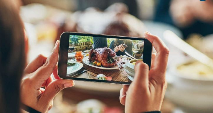 Person taking a picture of a thanksgiving turkey