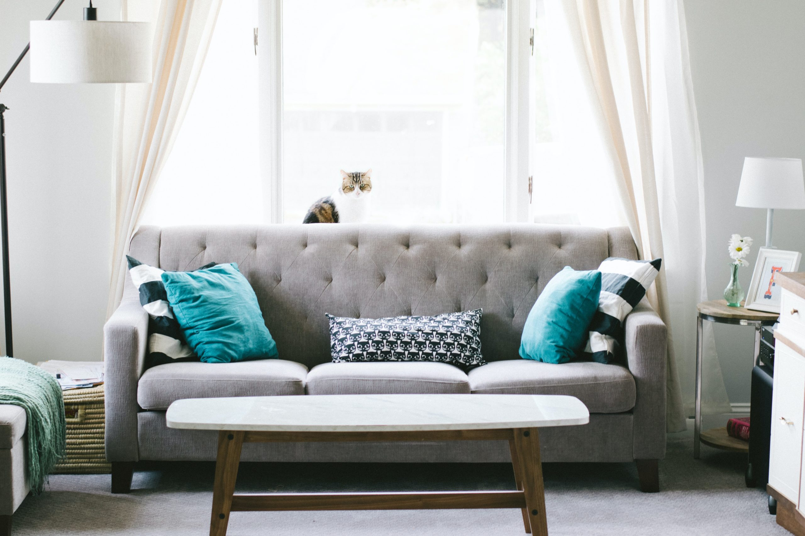 Couch with cross-stitched decorative pillows