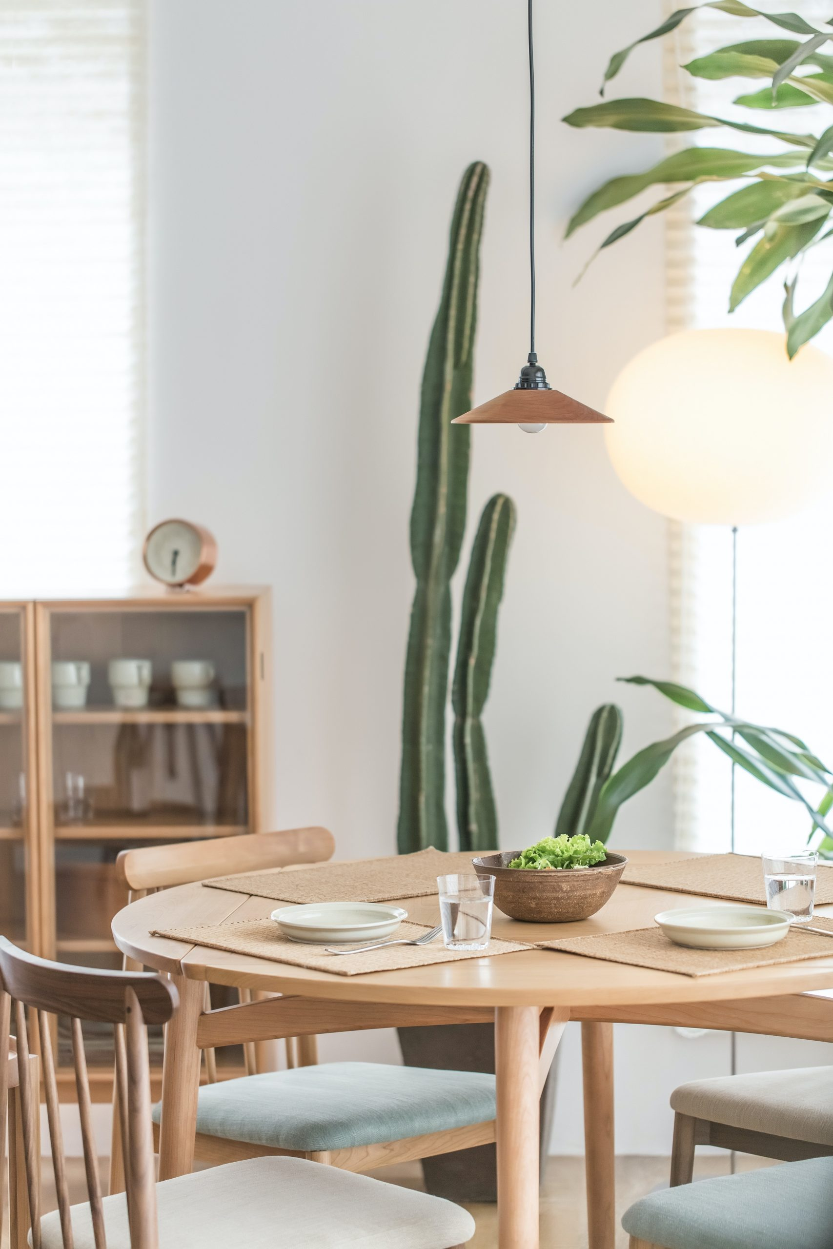 Rustic kitchen table with a cactus sitting behind it