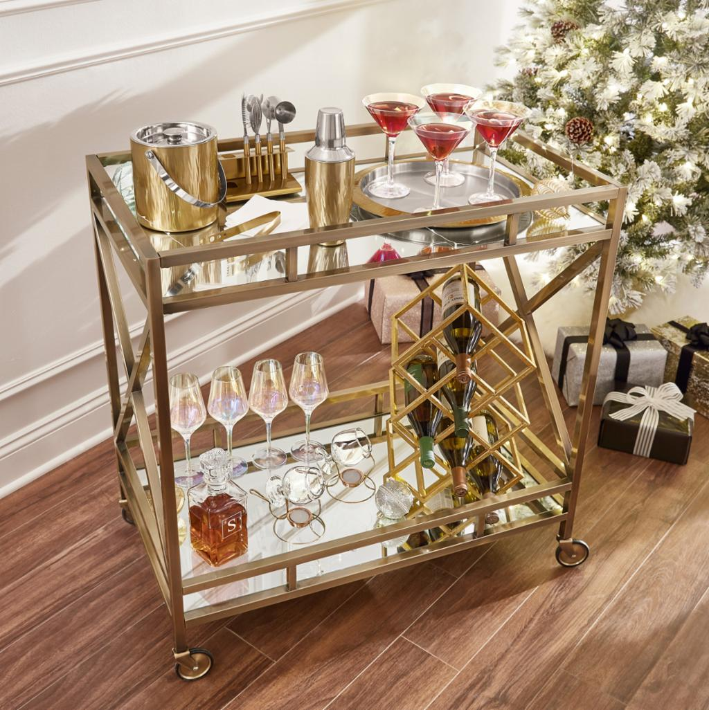 Bar cart with Christmas-themed cocktails prepared for serving.