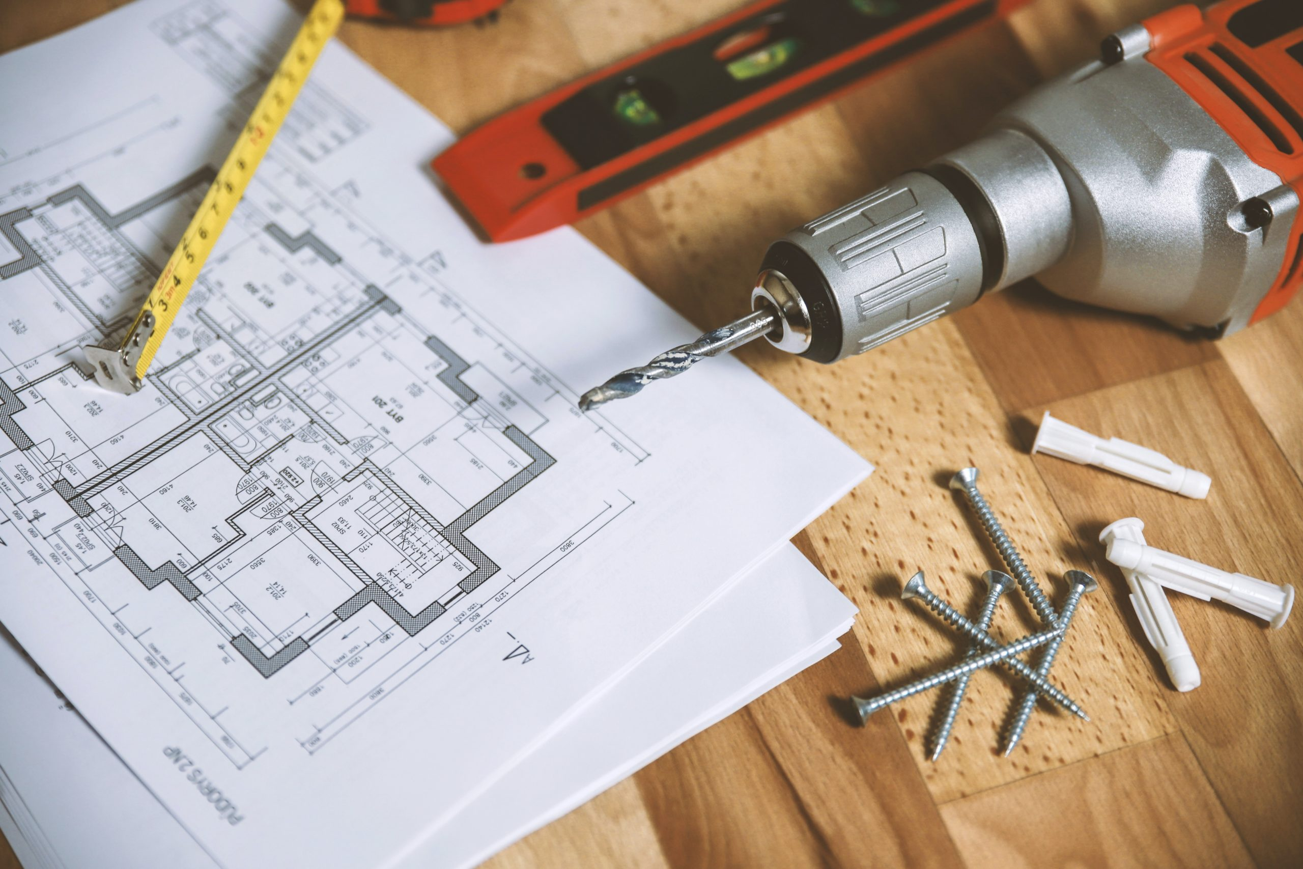 Drill and blue prints on a work table