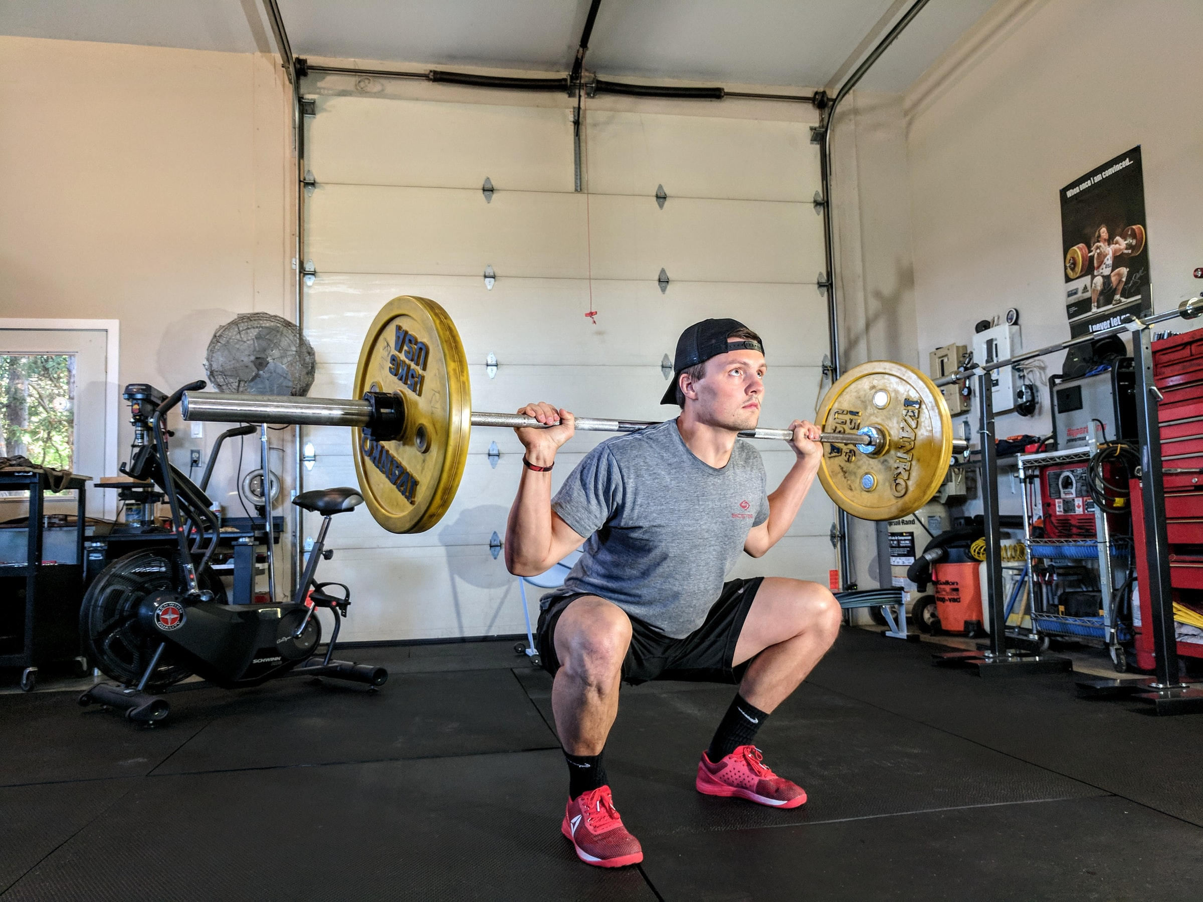 Man working out at home in garage