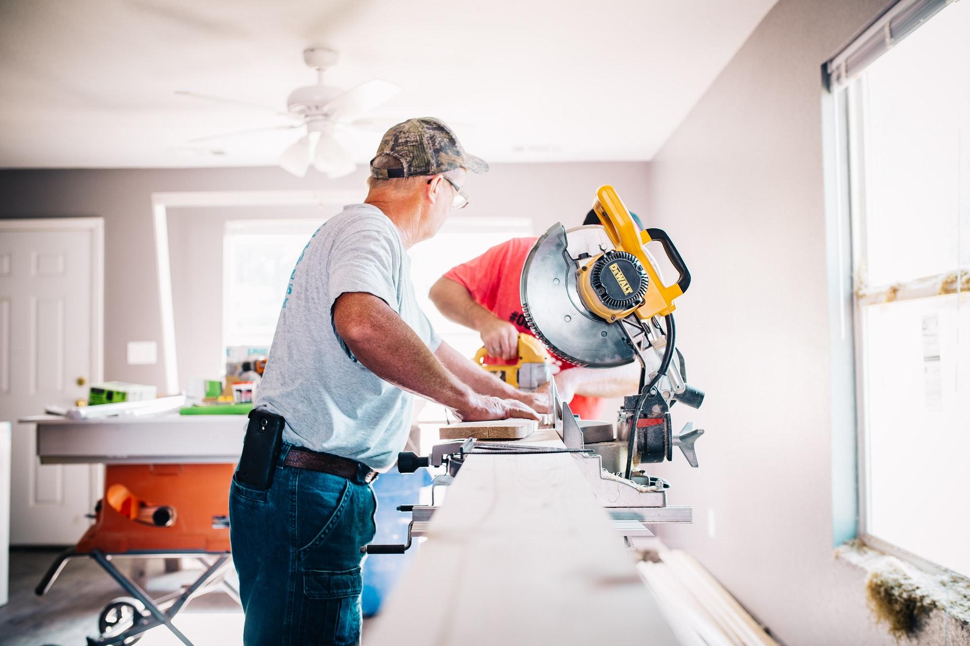 Men completing DIY renovation at home