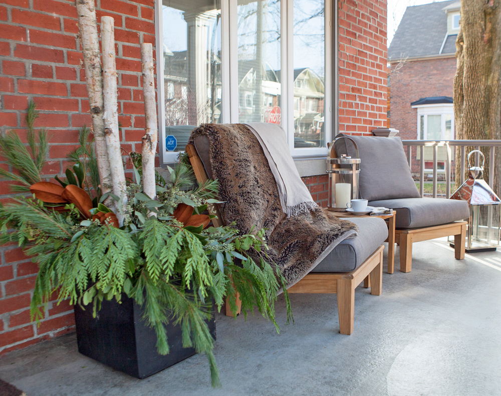 Front patio decorated with sitting chairs and plants