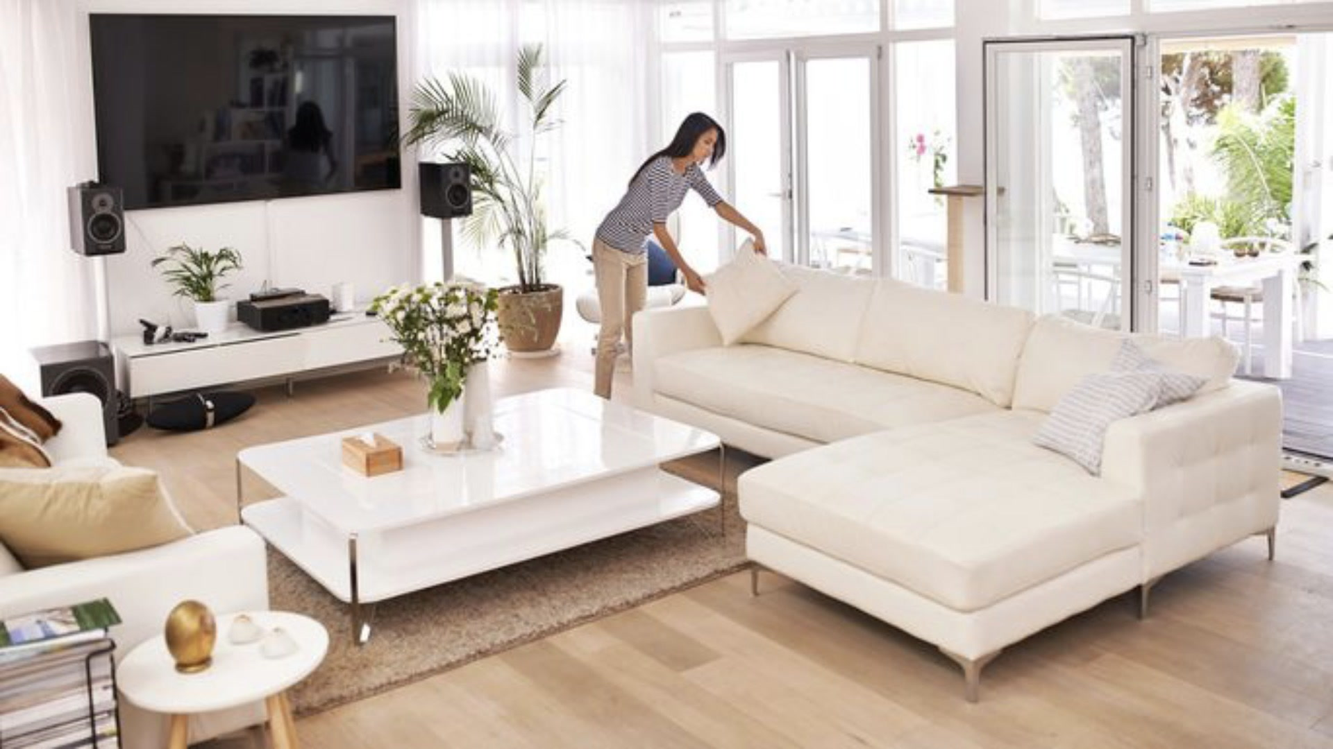home stager decorating an upscale living room