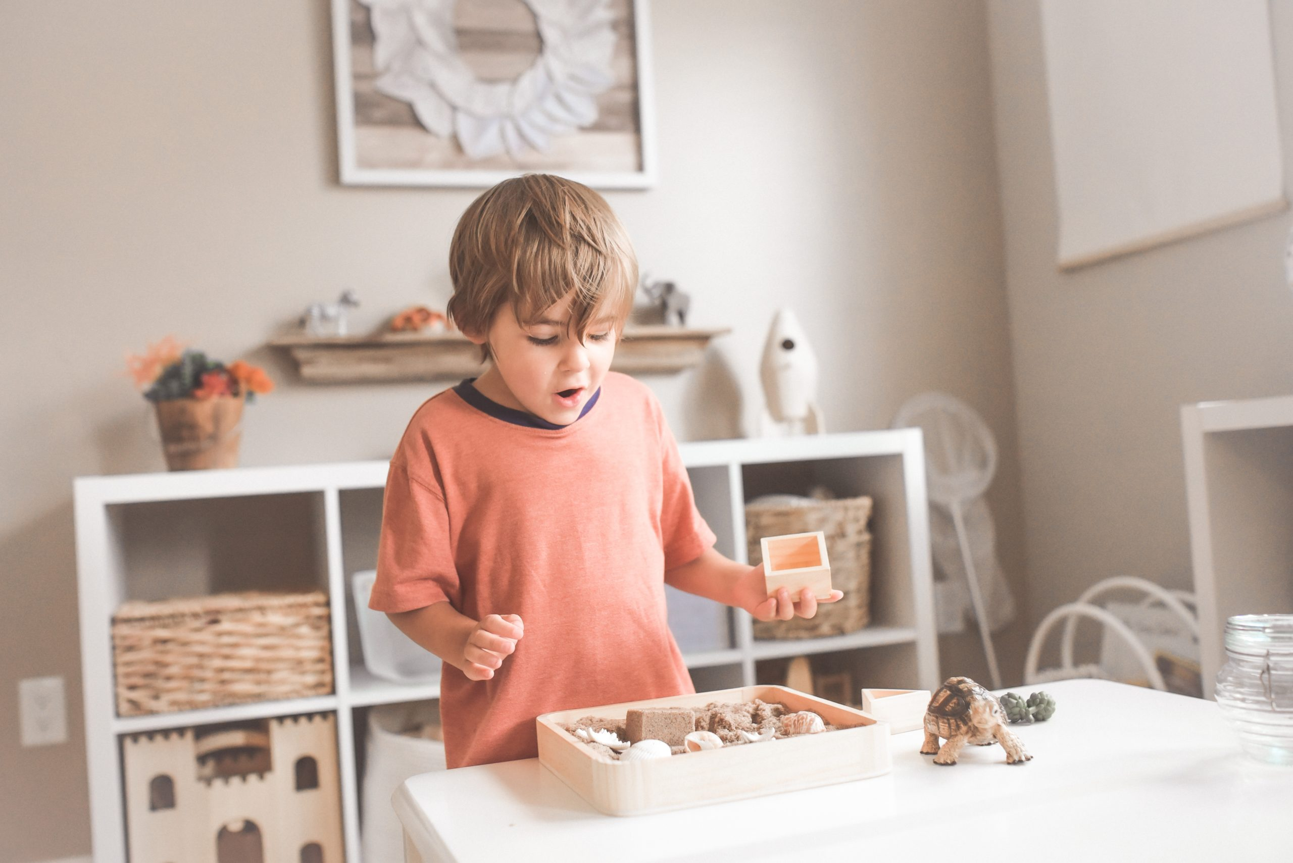 Child playing in room with toys