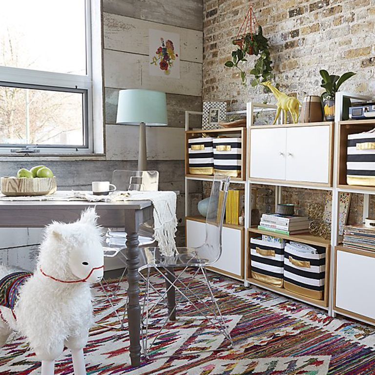 Elegant kids' room with stack crates used for storage