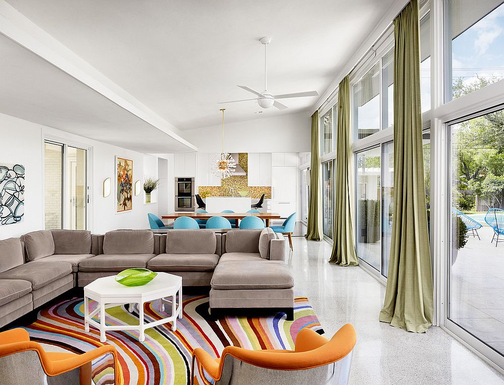 Staged living room with bold rug and accent chairs