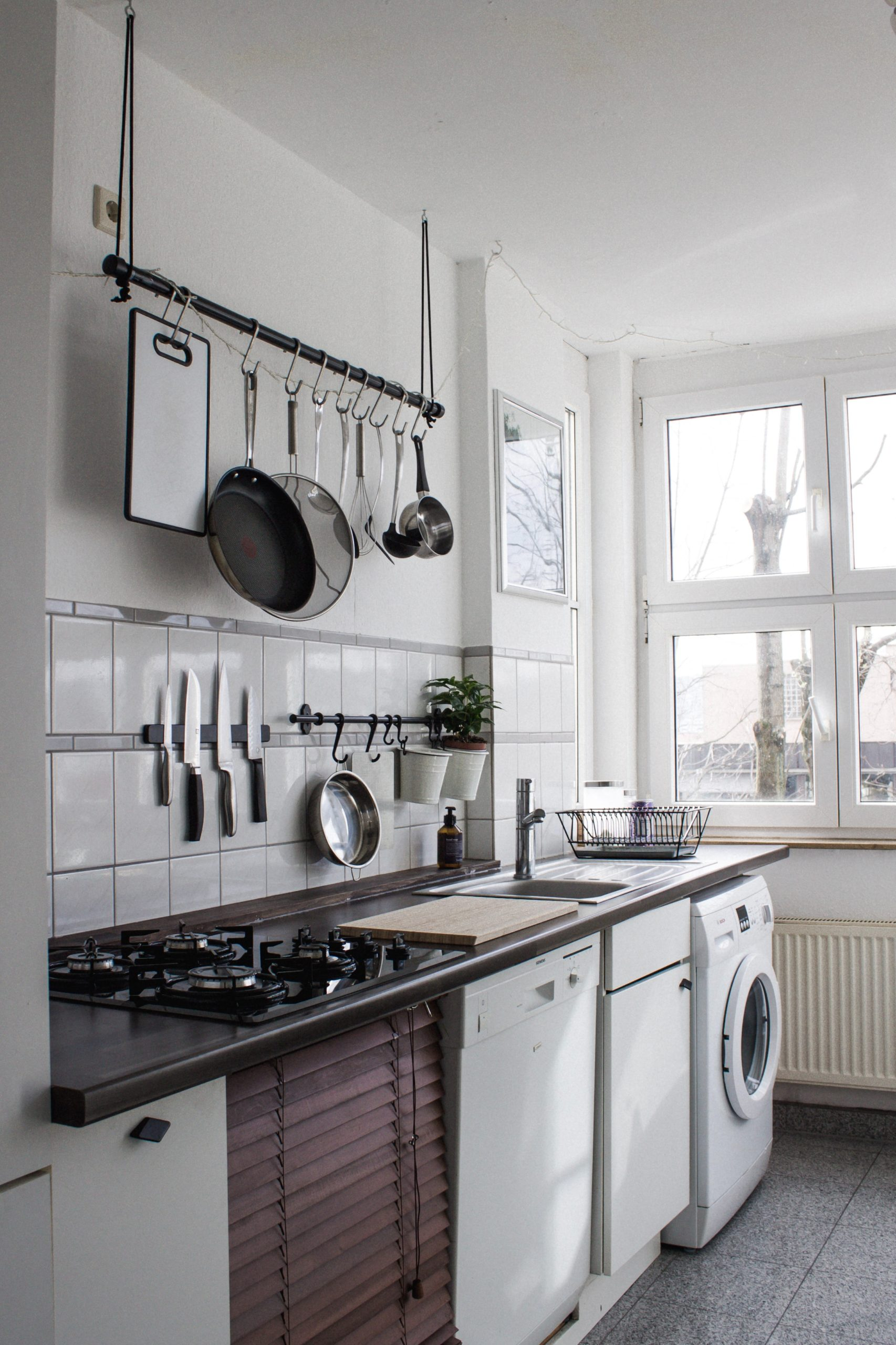 Kitchen with organized hanging pots and pans