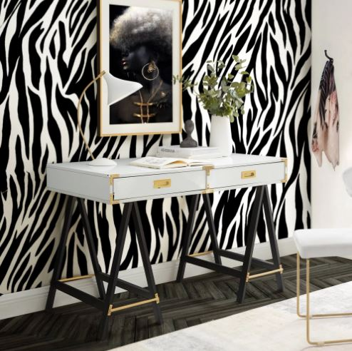 Zebra print accent wall with small desk in front