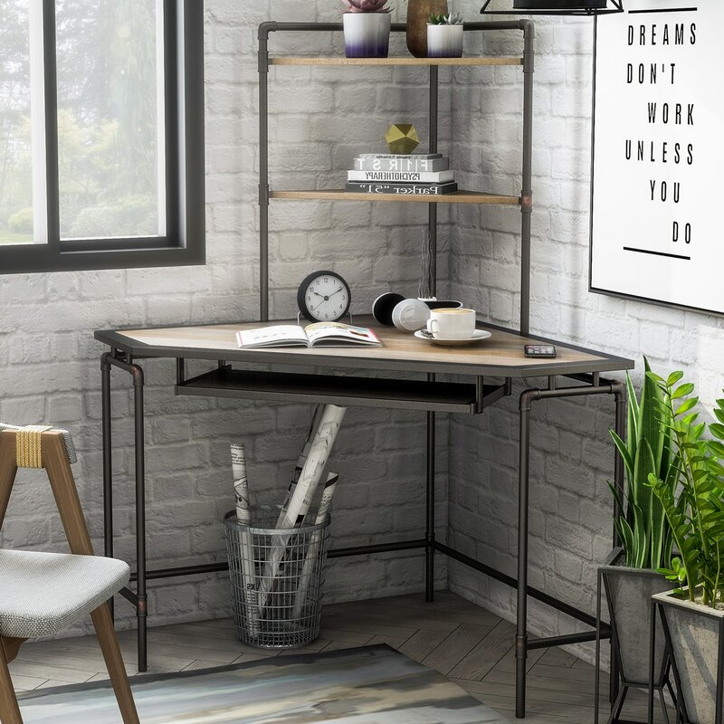 Corner home office desk with exposed brick walls