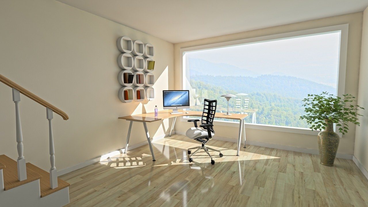 Modern home office with a large window overlooking the mountains