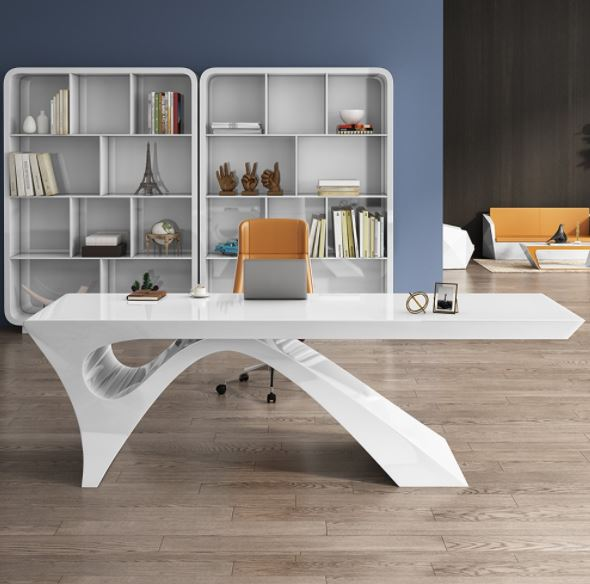 Modern curved white desk in a home office