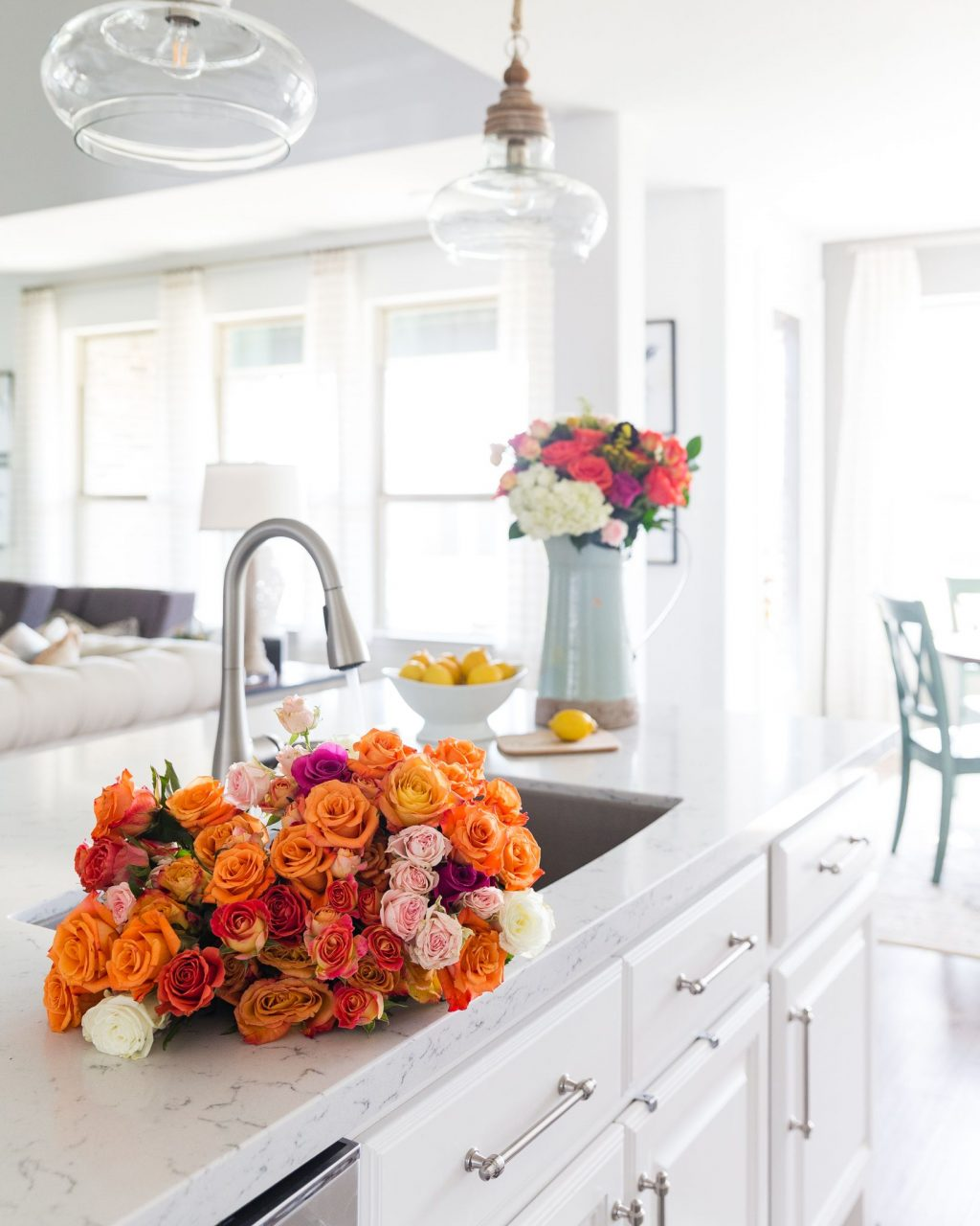 White kitchen with colorful flowers on the counter